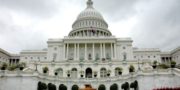 United States Capitol with fountain on a cloudy