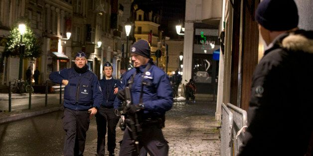 Police patrol during an operation in the center of Brussels on Sunday, Nov. 22, 2015. Western leaders...