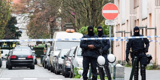 Armed police guard a street in Brussels on Monday, Nov. 16, 2015. A major action with heavily armed police...