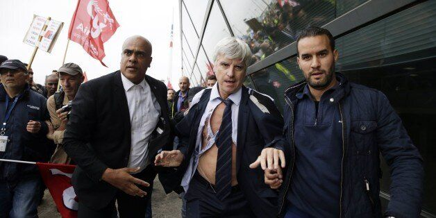 Director in charge of human resources of Air France long-haul flights, Pierre Plissonnier (C), nearly...