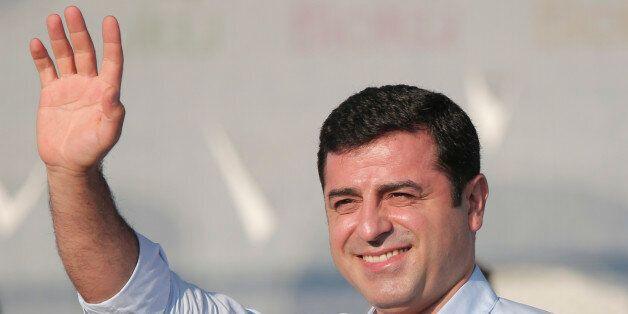 Selahattin Demirtas, leader of the pro Kurdish Democratic Party of Peoples (HDP) waves to people gathered...