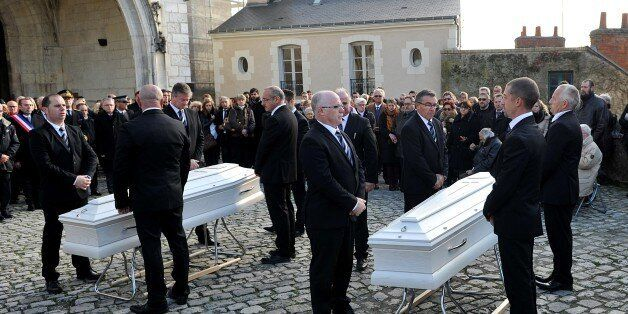 Friends and relatives of victims of the Paris terror attack claimed by the Islamic State group (IS) ,...