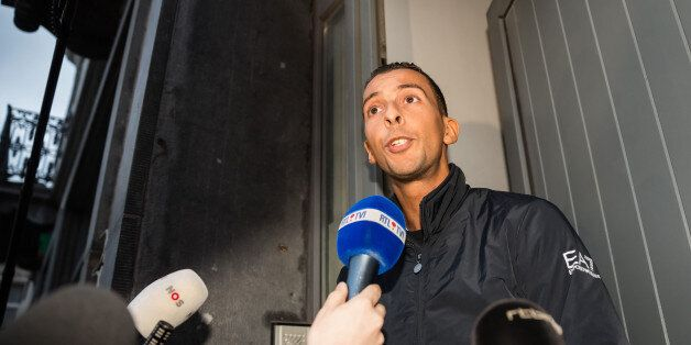 Mohamed Abdeslam addresses the media at his house in the Molenbeek neighborhood in Brussels on Monday,...