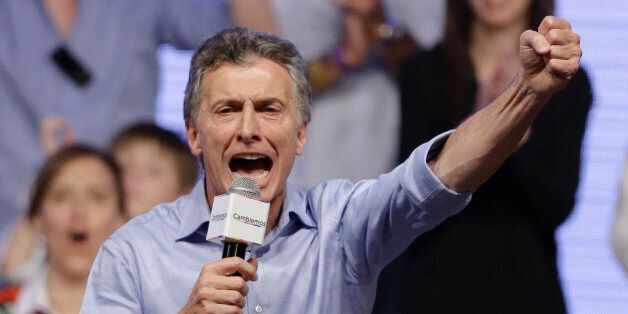 Opposition candidate Mauricio Macri celebrates after winning a runoff presidential election in Buenos...