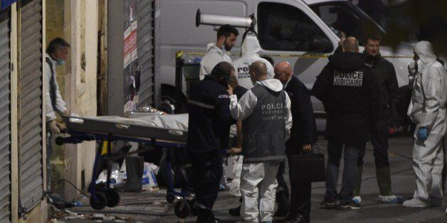 A second body is removed from the apartment raided by French Police special forces earlier in the northern...
