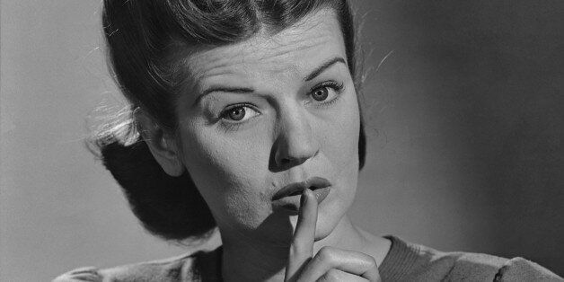 A woman signalling quiet, with her finger up to her lips, in the 1940's. (Photo by Keystone View/FPG/Getty