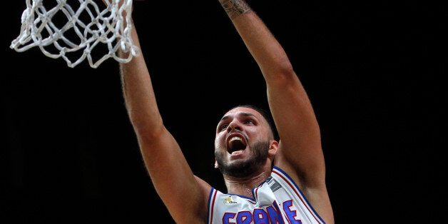 France's Evan Fournier dunks a basket during the EuroBasket European Basketball Championships match,...