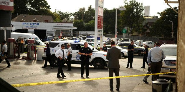 DENVER, CO. - SEPTEMBER 22, 2015: Police cover the entire area where 3 were wounded in a shooting at...