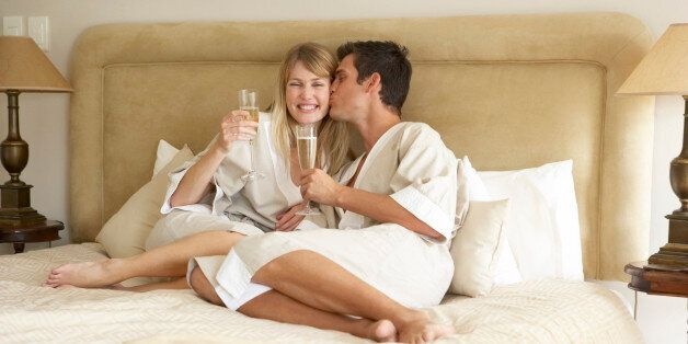 Young Couple Enjoying Champagne In