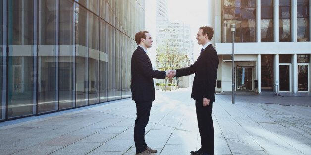 cooperation concept, handshake of two business