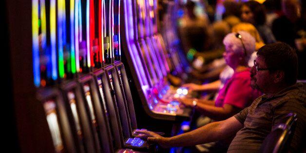 Guests play slot machines at Plainridge Park Casino in Plainville, Massachusetts, U.S., on Thursday,...