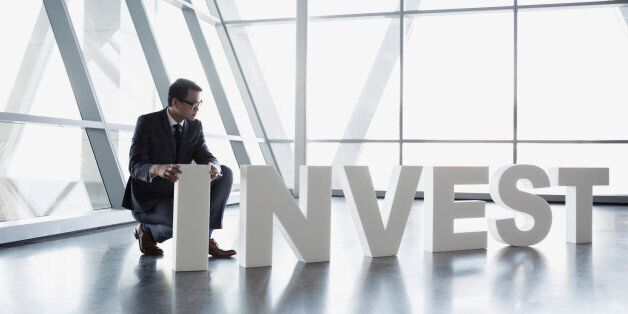 Businessman in suit arranging Invest