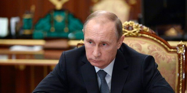 Russian President Vladimir Putin chairs a meeting on economic issues in the Kremlin in Moscow, Russia,...