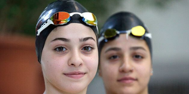 In this photo taken Monday, Nov. 9, 2015, Ysra Mardini, left, and her sister Sarah, right, from Syria...