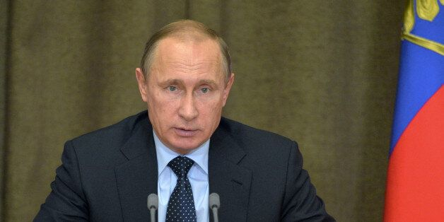 Russian President Vladimir Putin heads a meeting on military issues at the Russian Black Sea resort of...