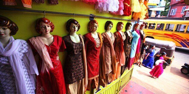 TRIVANDRUM, INDIA - DECEMBER 22: Shop dummies show the new collection of typical indian salwar kalmeez...