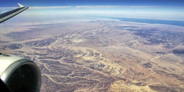 Plane over egyptian Desert on the Way to Hurghada with Gulf of Suez (Red Sea) and Sinai in the