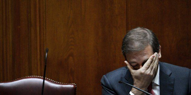 Portuguese Prime Minister Pedro Passos Coelho gestures during a debate at the Portuguese Parliament in...