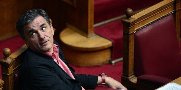 Greek Finance Minister Euclid Tsakalotos attends a debate at the Greek parliament in Athens on October...