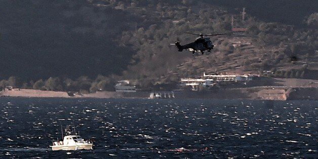 Greek coast guard try to save refugees and migrants during a rescue operation, after boat sunk while...