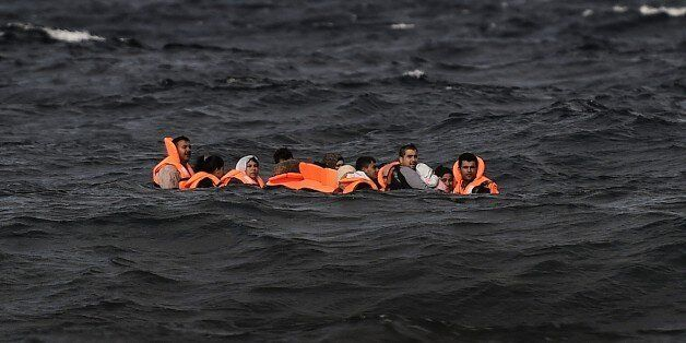 Refugees and migrants cross by boat the Aegean sea from Turkey, to reach the Greek island of Lesbos,...