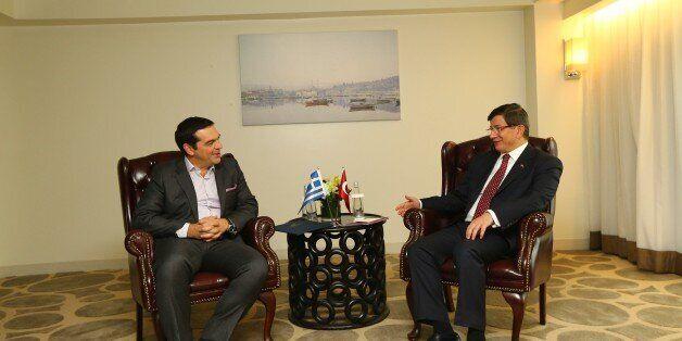 NEW YORK, USA - SEPTEMBER 29: Turkish Prime Minister Ahmet Davutoglu (R) and Greek Prime Minister Alexis...