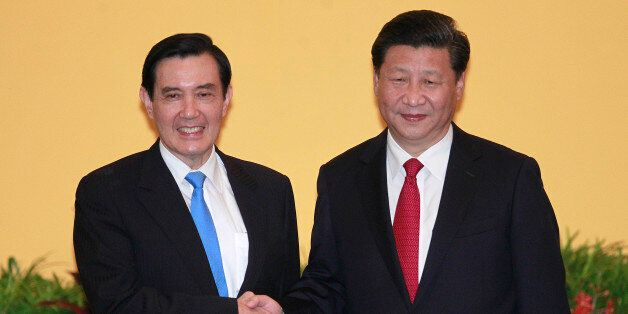 Taiwan's President Ma Ying-jeou, left, and China's President Xi Jinping shake hands at the Shangri-la...