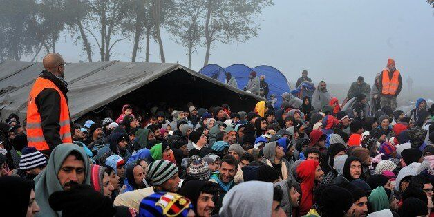 Middle-Eastern migrants wait to cross the Serbian-Croatian border near the village of Berkasovo, close...
