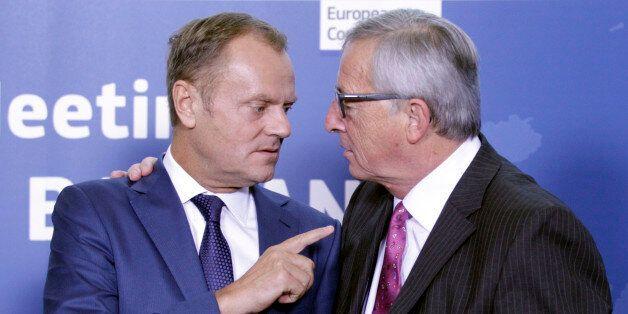 European Council President Donald Tusk, left, speaks with European Commission President Jean-Claude Juncker...