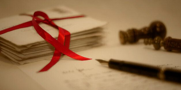 The pile of old letters (from the early 80s) was tied with the ribbon, with a pen, letter, red wax and...