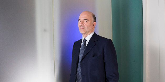Pierre Moscovici, economic commissioner for the European Union (EU), poses for a photograph following...