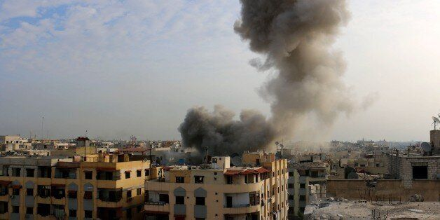 DAMASCUS, SYRIA - OCTOBER 28: Smoke rises after the war crafts belonging to the Syrian army bombed opposition-controlled...