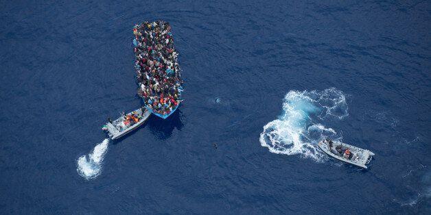 June 7, 2014 - Mediterranean Sea / Italy: Italian navy rescues asylum seekers traveling by boat off the...