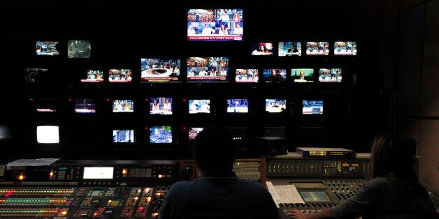 Employees of the Greece state broadcaster ERT in the control room at the television station's headquarters...