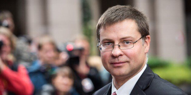 Latvian Prime Minister Valdis Dombrovskis arrives for an EU summit on Thursday, Oct. 24, 2013. A two-day...