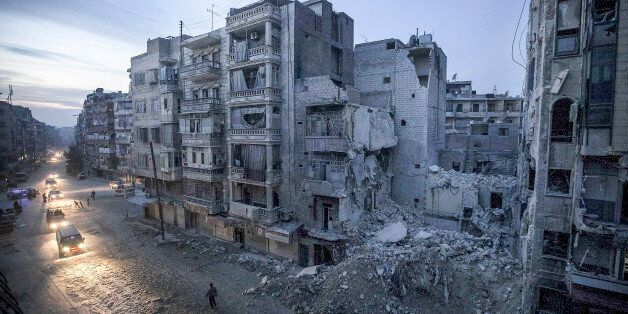 Dar Al-Shifa hospital (seen partially to the right of the frame) was bombed by a plane. The hospital...