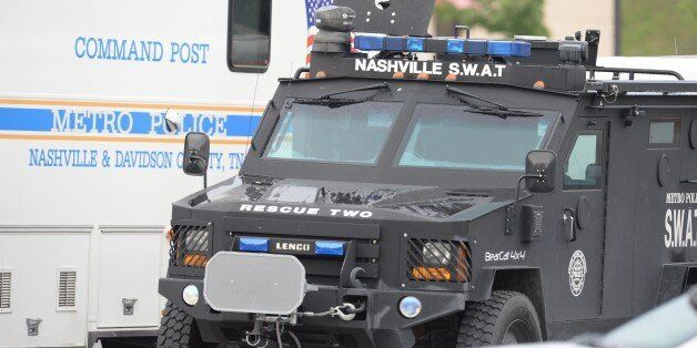 ANTIOCH, TN - AUGUST 05: SWAT and Nashville Metro Police trucks park outside Hickory Hollow Cinemas on...