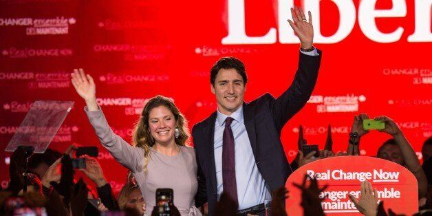 Canadian Liberal Party leader Justin Trudeau and his wife Sophie wave on stage in Montreal on October...