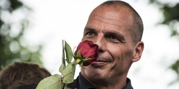 Former Greek Finance Minister Yanis Varoufakis smells a rose during the 43rd annual Fete de la Rose political...
