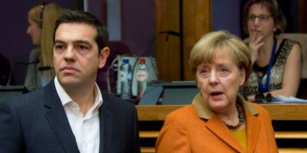 German Chancellor Angela Merkel, right, and Greek Prime Minister Alexis Tsipras arrive for a round table...