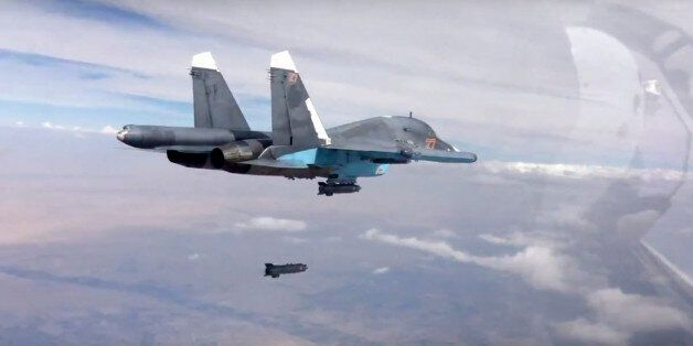 FILE - In this file photo made from the footage taken from Russian Defense Ministry official website...