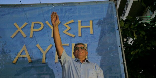Nikos Michaloliakos, the leader of the extreme far-right Golden Dawn political party salutes his supporters...