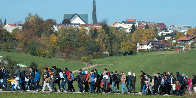 Migrants are led by German Federal Police to an emergency accommodation center in Wegscheid, southern...