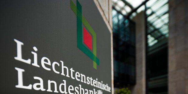 A logo sits on a sign outside a Liechtensteinische Landesbank AG (LLB) bank branch in Vaduz, Liechtenstein,...