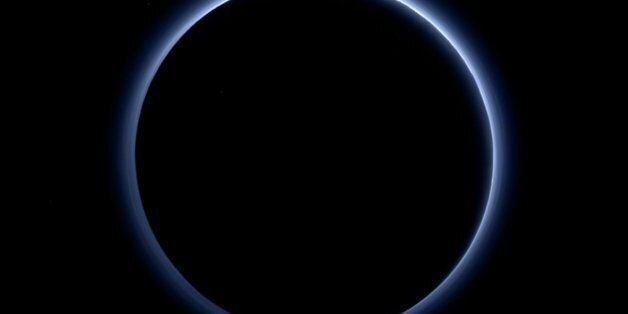 Pluto's Blue Sky: Pluto's haze layer shows its blue color in this picture taken by the New Horizons...