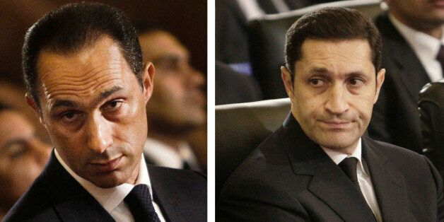 FILE - This combination of Jan. 6, 2011 file images shows Gamal Mubarak, left, and Alaa Mubarak, right,...