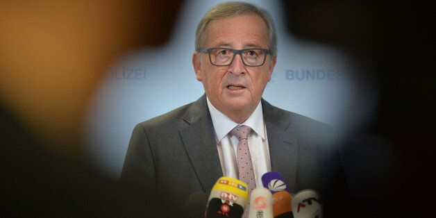 President of the European Commission Jean-Claude Juncker speaks to media during a visit of a migrants...
