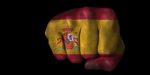 Flag of Spain painted on closed fist. See