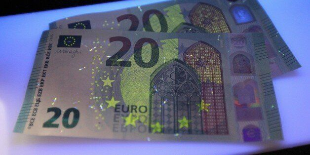 New 20 Euro notes are seen in Frankfurt am Main, western Germany, on March 4, 2015. According to the...