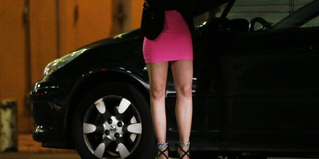 A prostitute waits for clients in a street of the French southeastern city of Nice, on September 5, 2015....